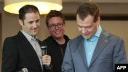 Russian President Dmitry Medvedev sends his first tweet as Twitter co-founders Biz Stone (center) and Evan Williams look on at Twitter headquarters in San Francisco.