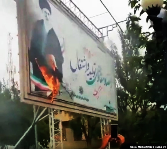 A billboard with a big picture of Supreme Leader Ali Khamenei, has been set on fire in the recent protests in Iran.