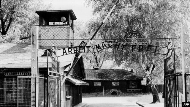 """Auschwitz concentration camp gate, with the inscription """"Arbeit macht frei"""", after its liberation by Soviet troops in January 1945"""
