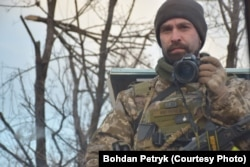 """Bohdan Petryk, a soldier in the 128th Mountain Assault Brigade, says being on the front line is in a way a form of """"self-isolation."""" """"You are in a position and you can't leave to go just anywhere,"""" he said."""