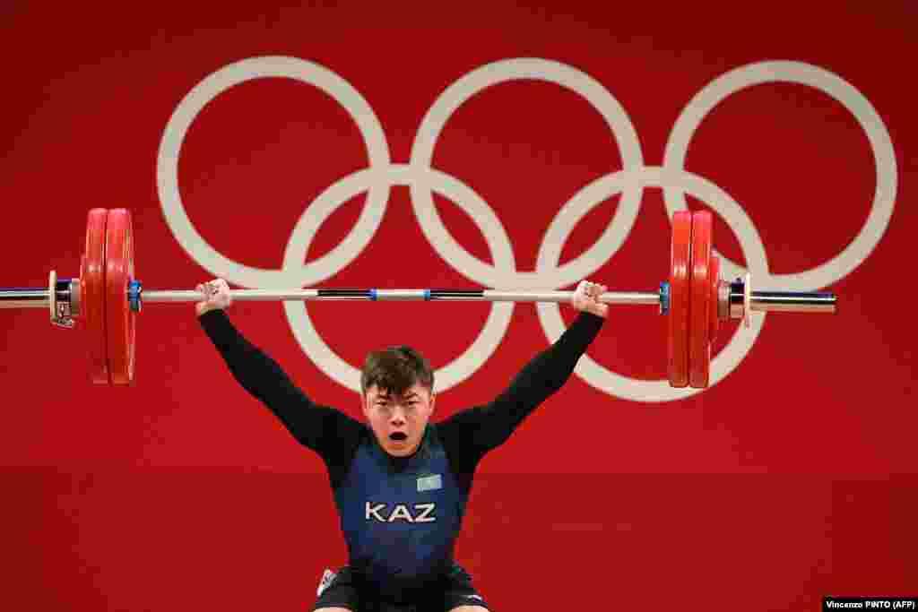 Игорь Сон (Казахстан) участвует в соревнованиях по тяжелой атлетике среди мужчин в весовой категории до 61 кг на Олимпийских играх Токио-2020. Игорь Сон из Казахстана стал бронзовым призером