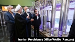 President Hassan Rohani (center) reviews Iran's new nuclear achievements during National Nuclear Energy Day in Tehran on April 10.