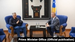 Kosovar President Hashim Thaci (left) meets with the country's prime minister, Ramush Haradinaj (file photo)