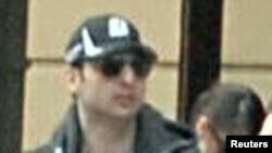 U.S. - Dzokhar (left) and Tamerlan Tsarnaev, suspects wanted for questioning in relation to the Boston Marathon bombing April 15 are seen in handout photo released through the FBI website, 18Apr2013