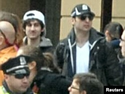 An FBI handout photo of Boston Marathon bombing suspects Dzhokhar (left) and Tamerlan Tsarnaev in the crowd near the finish line on April 15.