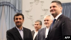 Iranian President Mahmud Ahmadinejad (left) greeting Armenian Prime Minister Tigran Sarkisian in Tehran on October 26