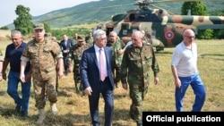 Nagorno Karabakh - Armenia's President Serzh Sarkisian (C), visits a military base, 22Jun2016