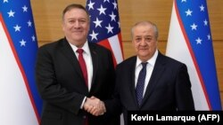 U.S. Secretary of State Mike Pompeo (left) shakes hands with Uzbek Foreign Minister Abdulaziz Kamilov in Tashkent on February 3.