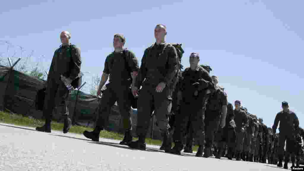 NATO peacekeepers from Austria march together after arriving at Djakovica Airport in Kosovo on April 27. (Reuters/Hazir Reka)