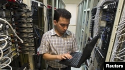 A computer engineer checks equipment at an internet service provider in Tehran in February 2011.