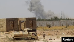 Smoke rises from clashes near Fallujah on May 30.