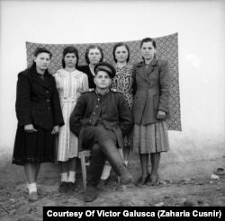 Tokarchuk in his military uniform posing with local girls. Tamara is standing second from right.