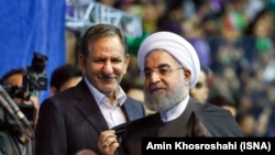 Iran -- President Hassan Rouhani (R) and his first deputy Eshagh Jahangiri, during a campaign rally in Tehran on Sunday May 13, 2017.