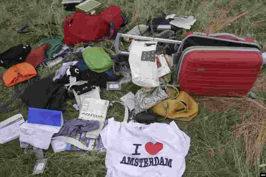 Passengers' personal belongings and luggage amid the debris of the Boeing 777 jet.