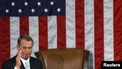 U.S. -- Incoming House Speaker John Boehner salutes the assembled members of congress as he takes the podium in front of the speaker's chair after being elected Speaker, Washington, DC, 05Jan2011