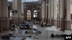 Pakistani Muslims rest at a mosque during a heatwave in Karachi on June 22.