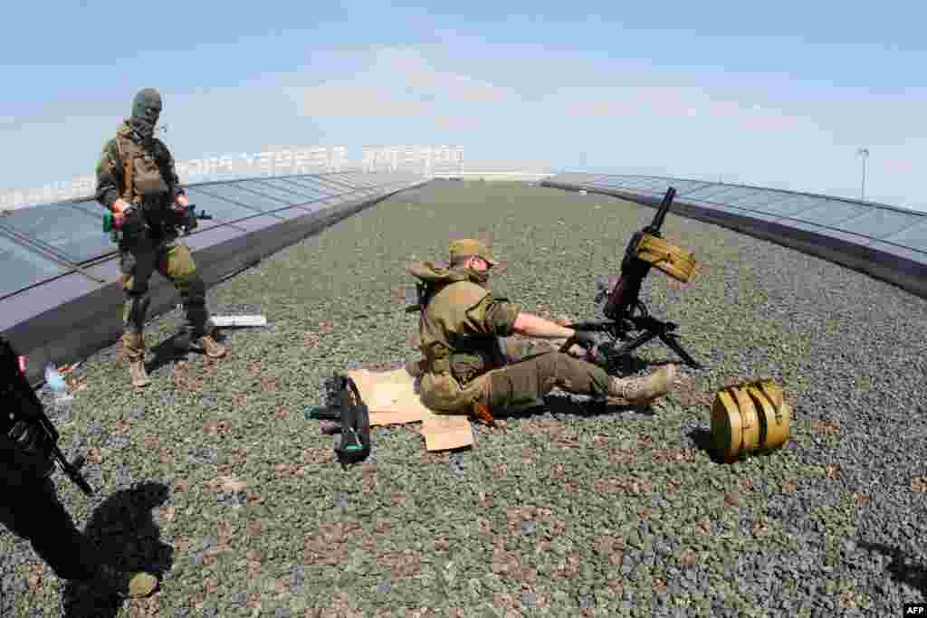 The militants set up a mortar launcher atop Donetsk's international airport.