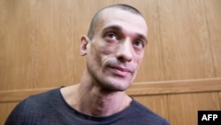 Russian performance artist Pyotr Pavlensky is facing criminal charges for setting fire to a door of the Federal Security Service's (FSB) headquarters in Moscow in November.