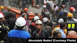 Coal miners and rescue workers gather at the scene of an explosion at a mine in Golestan Province that killed at least 35 people.