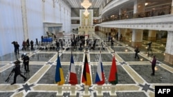 The flags of France, Russia, Germany, Ukraine, and Belarus are prepared at the presidential residence in Minsk ahead of talks set for later on February 11.
