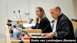 Sabine ten Doesschate and Boudewijn van Eijck, lawyers for one of the defendants Oleg Pulatov, in court on June 8.