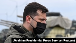 Ukrainian President Volodymyr Zelenskiy visits a military fortification on April 27 in an area bordering the Crimean Peninsula, which was forcibly seized by Russia in 2014.