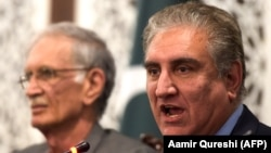 Pakistani Foreign Minister Shah Mehmood Qureshi (right) said the attackers wore military uniforms. (file photo)