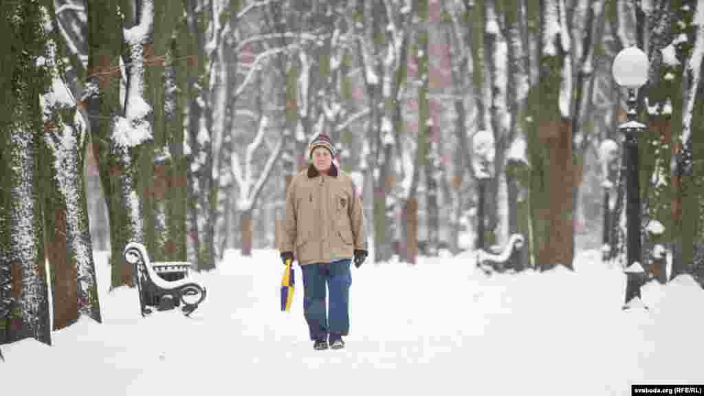 A man walks in a park in the Belarusian capital, Minsk, which is covered in snow this week. (RFE/RL)