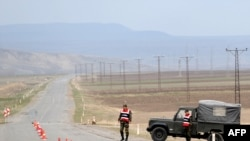 Turkish soldiers guard a road at Dogu Kapi, on the Turkish-Armenian border, on April 15.