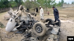 Pakistani security officials inspect the vehicle of a tribal elder who was killed when his vehicle was hit by a roadside bomb in Bajaur near the Afghan border in November 2015.