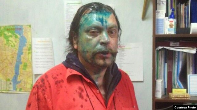 "Andrei Yurov says two masked men hit him and splashed the indelible green antiseptic known as ""zelyonka"" on his face."