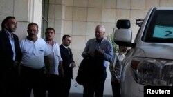 Представители инспекции ООН по химическому оружию прибыли в Дамаск. 18 августа 2013 года.