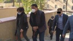 From untouchable to handcuffs: Raimbek Matraimov is detained in Bishkek on October 20.