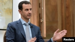 Syrian President Bashar al-Assad speaks during an interview with Yahoo News on February 10.