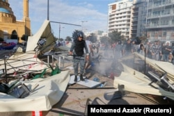 Lebanese police stand near destroyed tents, that were set-up by anti-government protesters in Beirut, Lebanon October 29, 2019