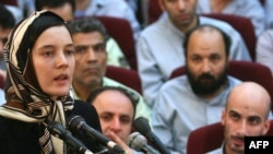 Clotilde Reiss defends herself during a hearing at a court in Tehran in August.