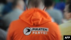A delegate wears a sweatshirt with the Pirate Parties International (PPI) logo during their international conference in Prague earlier this month.