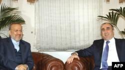 Azerbaijani Foreign Minister Elmar Mammadyarov (right) meets with his Iranian counterpart, Manuchehr Mottaki, in Baku.