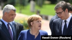 German Chancellor Angela Merkel (center) speaks with Serbian President Aleksander Vucic (right) and Kosovar President Hashim Thaci during the EU-Western Balkans summit in Sofia on May 17.