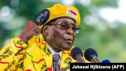 Роберт Мугабе на 100-тысячном митинге своих сторонников в столице Хараре, за 10 дней до свержения. 8 ноября 2017 года