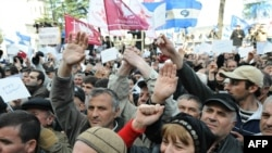 Georgian protesters chant slogans at a rally in Tbilisi on April 10