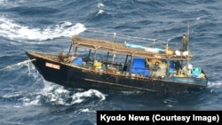 Despite the risks involved, poor North Koreans continue to fish in the Sea of Japan using simple wooden boats. (file photo)