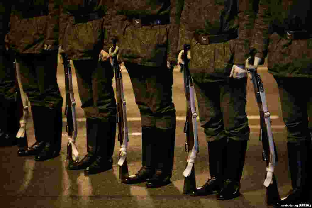 Soldiers holding weapons during the rehearsal.