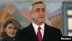 Armenia -- President Serzh Sarkisian and his wife Rita leave a polling station after voting during the presidential election in Yerevan, 18feb2013