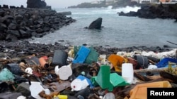 Azores -- A beach in the Azores is pictured littered with plastic garbage, undated