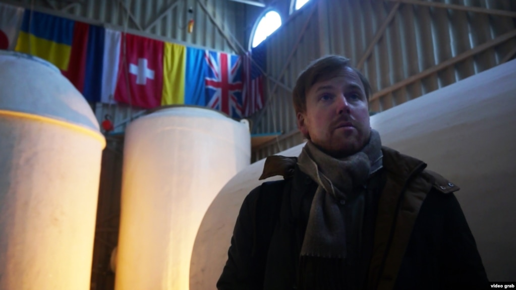 Danila Medvedev, one of the founders of KrioRus, stands in front of vats that contain the frozen remains of his customers.