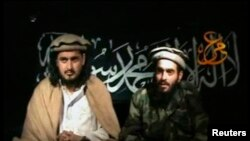 The late Pakistan Taliban leader Hakimullah Mehsud (left) sits beside a man who is believed to be the suicide bomber who killed CIA agents in 2009.