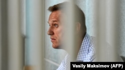 Russian opposition leader Aleksei Navalny attends a hearing at a court in Moscow on June 24.