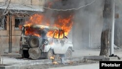 Armenia - A police car is set on fire in Yerevan, 1 March 2008.
