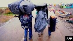 Родина біженців прибула до Угорщини, 10 вересня 2015 року